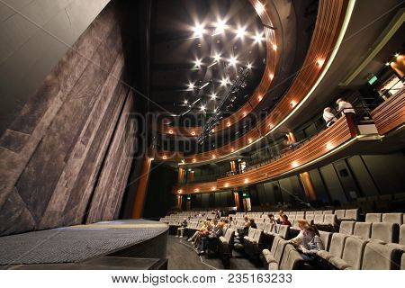MOSCOW - SEP 14, 2017: The auditorium with a stage and balconies in the Moscow Theater Center Cherry Orchard. The hall can seat 300 spectators