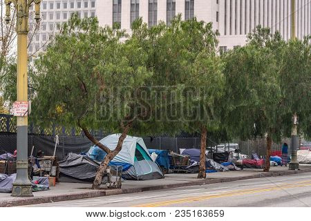 Los Angeles, Ca, Usa - April 5, 2018: Row Of Tents And Sleeping Bags On Sidewalk Of N. Grand Street