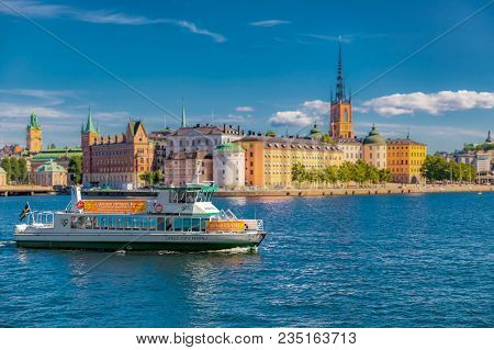 Stockholm, Sweden - August 17, 2017: Tourist Ferry On Lake Malaren With Traditional Gothic Buildings