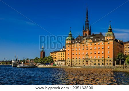 Stockholm, Sweden - August 17, 2017: View Across Lake Malaren To Traditional Gothic Buildings In Old