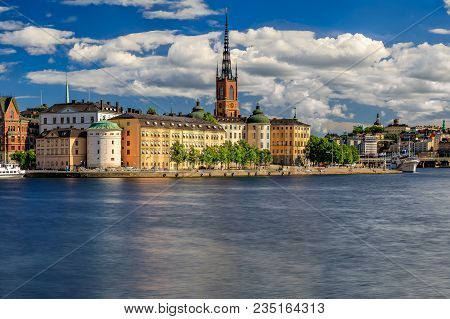 Panoramic View Of Traditional Gothic Buildings Across Lake Malaren, In The Old Town, Gamla Stan  And