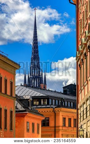 Traditional Gothic Buildings And  Riddarholmen Church Spire In The Old Town Part Of Sodermalm Island