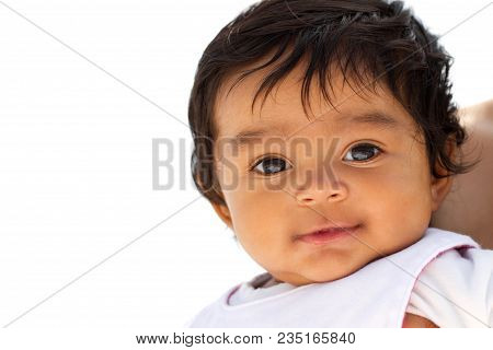 Portrait Of A Cute Little Hispanic Baby Smiling.