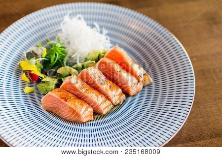 Healthy Raw Salmon Tataki Dish. Slices Of Sashimi Grade Salmon Seared Lightly To Keep The Fish Raw I