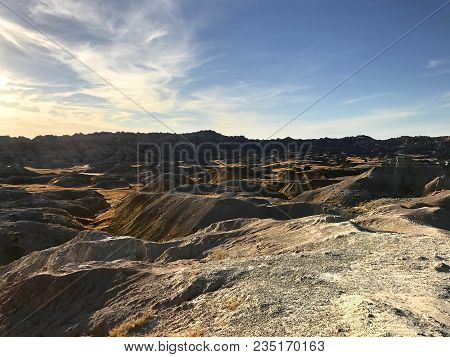 Views Of The Sunlight And Shadows On The Stunning Landscape Of Badlands National Park In South Dakot