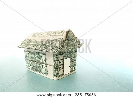 Origami House Made Out Of Dollar Bills With White Door