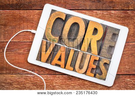 core values  banner  -  word abstract in vintage letterpress wood type blocks on a digital tablet against rustic wood