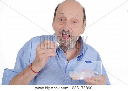 Close Up View Of Senior Man Taking Pill. Medicine Concept. Isolated White Background