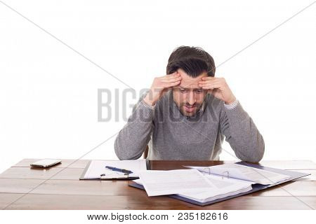 worried man working on a desk, isolated on white background