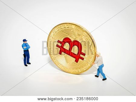 Miniature Police Officer Arresting Thief Stealing Bitcoin. Digital Currency Blockchain Crytocurrenci