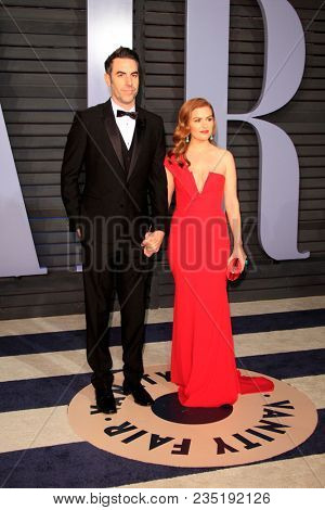 LOS ANGELES - MAR 4:  Sacha Baron Cohen, Isla Fisher at the 24th Vanity Fair Oscar After-Party at the Wallis Annenberg Center for the Performing Arts on March 4, 2018 in Beverly Hills, CA