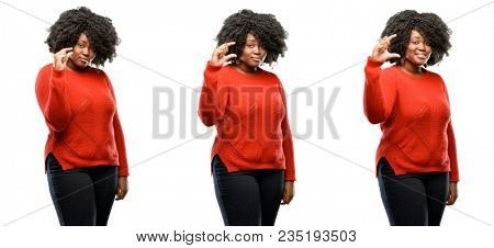Young beautiful african plus size model holding something very tiny, size concept isolated over white background. Collection composition 3 figures collage