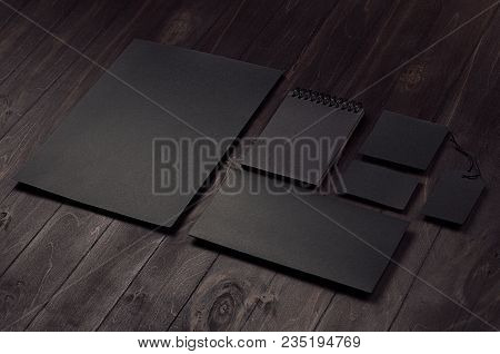 Corporate Identity Set Of Blank Black Letterhead, Envelope, Notepad, Business Card On Dark Wood Boar
