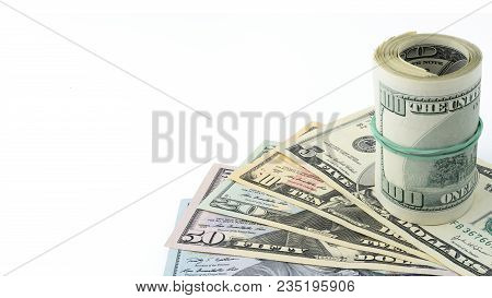 Rolled Hundred Dollar On Background Series American Money  5,10, 20, 50, New 100 Dollar Bill. Many U