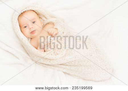 Newborn Baby, New Born Kid Swaddled In White Blanket, One Month Old Infant Child Portrait