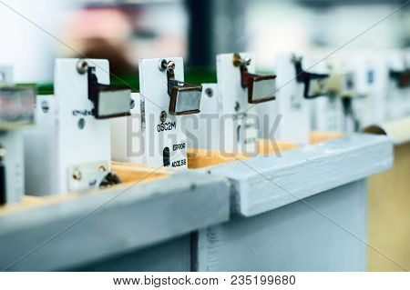 Ready-made Electronic Boards Stand In Wooden Boxes. Warehouse Of Electronic Printed Circuit Boards A