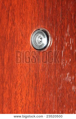 Peephole on wooden door
