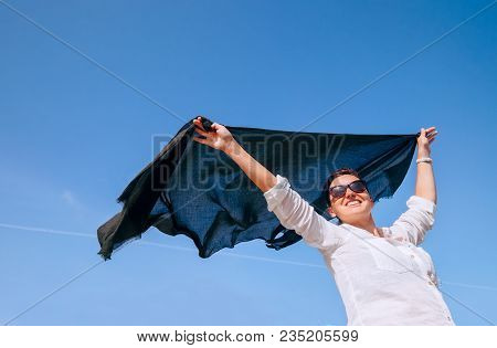 Woman Take In Hands Light Shawl Fluttering On The Wind