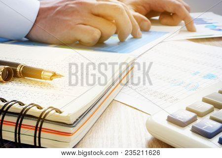 Manager Working With Business Papers In The Office. Financial Audit.