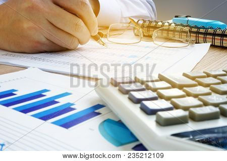 Man Checking Financial Account In Office. Business Audit.