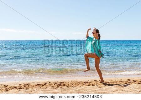 Beach Vacation Success Woman Jumping Of Joy And Happiness. Girl Jump On A Beach On Summer Vacations