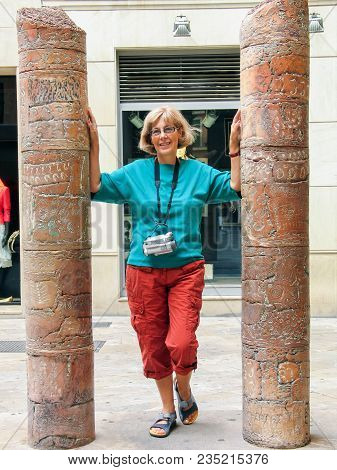 Beautiful Mature Happy Tourist Woman With Old Video Camera On Her Neck Travelling In Palma De Majorc