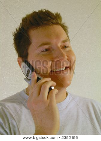Man Smiling On A Cell Phone