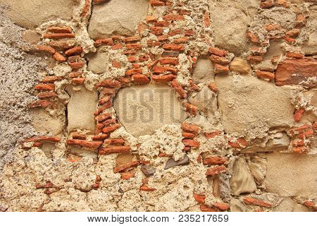 Old Wall Of Big And Small Stones. Terracotta And Beige Stones. Terracotta Background. Background Of