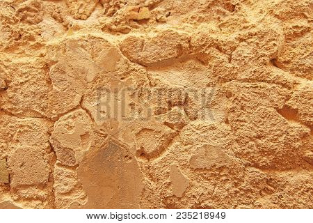 Old Wall Of Stones. Terracotta And Beige Stones. Terracotta Background. Background Of The Old Terrac