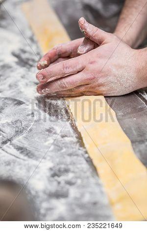 Chef's Hands Prepares Italian Food Stuffed Pasta Ravioli