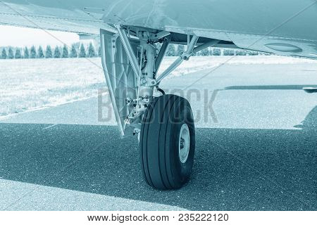 Wheel Of Airplane. Close Up Of Aircraft Wheel On Runway. Plane Wheel, Jet Plane, Blue Colored