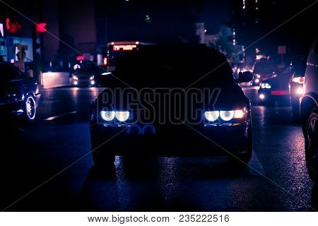 Road In The City At The Night With Yellow And Red Electrical Light For Cars During They Are Coming H