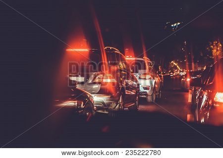 Cars Are Red, Yellow Night Light. Looking Behind The Cars.cars Are Red, Yellow Night Light. Traffic