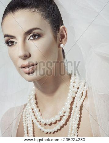 Closeup portrait of beautiful young bride looking away.