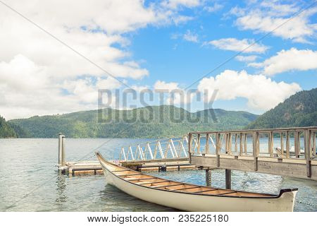 Wooden Boat Pier On Serene Beautiful Mountain Lake On Olympic Peninsula