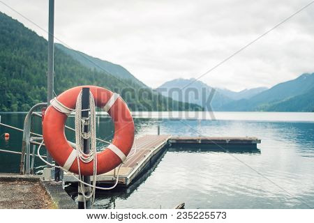 Wooden Boat Pier On Serene Mountain Lake On Olympic Peninsula