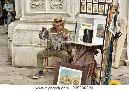 Italy Venice. May 07,2017. The Artist Sells Pictures On The Street.
