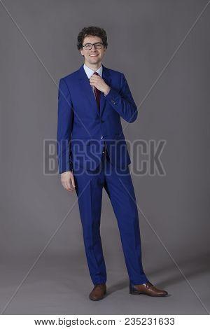 Happy Kinky Boy Taking Off His Necktie