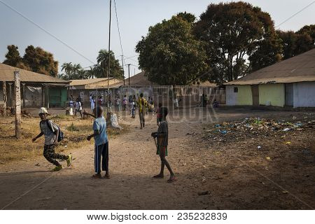 Bissau, Republic Of Guinea-bissau - January 29, 2018: Group Of Children Playing Outside Their School