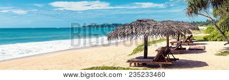 Beach Beds With Umbrellas On The Tropical Beach. Horizontal Bunner For Website Header. Panoramic Sce