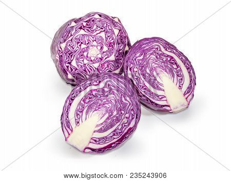 Two Halves Of The Red Cabbage Head Cut Along And One Half Cut Across On A White Background