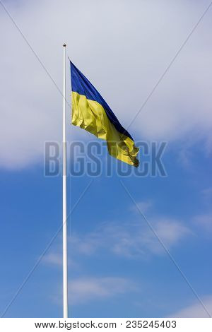 National Flag Of Ukraine Consisting Of Horizontal Bands Of Blue And Yellow Colors Flying In The Wind
