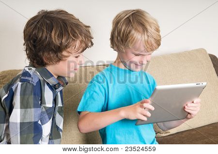Kid Working On A Tablet Computer