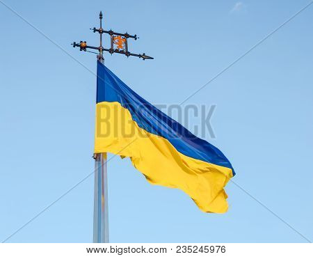 National Flag Of Ukraine Of Blue And Yellow Colors Flying In The Wind On The Flagpole On The Lviv Hi