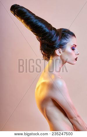 Nude Art Woman With Hair In The Form Of Horns, A Female Demon With Bright Makeup, Perfect Body Girl,
