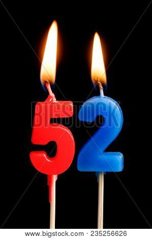 Burning Candles In The Form Of 52 Fifty Two (numbers, Dates) For Cake Isolated On Black Background.