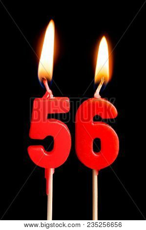Burning Candles In The Form Of 56 Fifty Six (numbers, Dates) For Cake Isolated On Black Background.