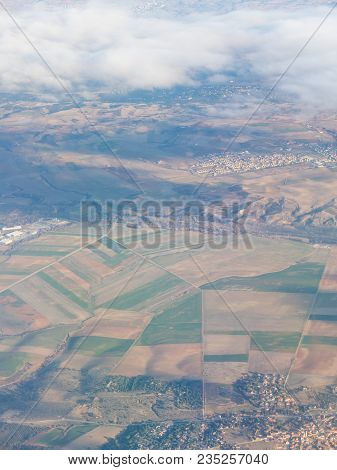 Aerial View Of The Madrid Region, Outside The Metropolitan Area. Flying Over Agricultural Fields And