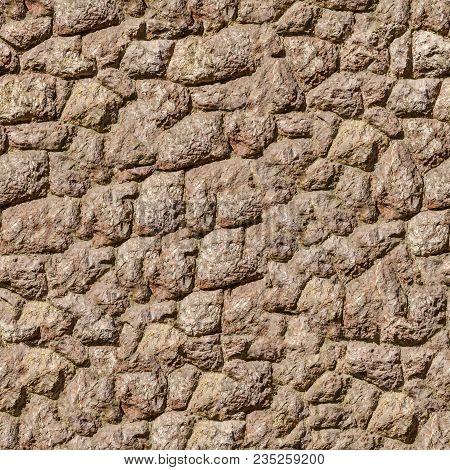 Natural Brown Rock Stone Wall Texture. Texture Of A Medieval Castle Wall. Seamless Tileable Texture.