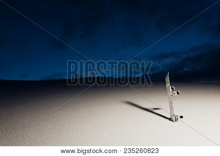 Snowboard On The Slope At Sunset And Powder Texture